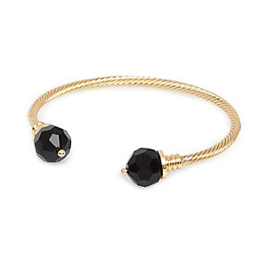 Gold tone twist black stone bangle