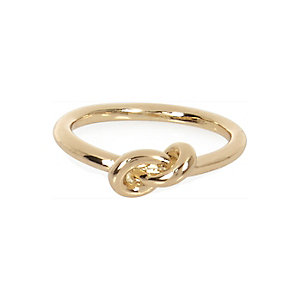 Gold tone knot ring