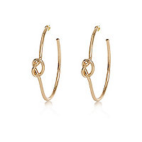 Gold tone knot hoop earrings
