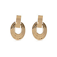 Gold tone door knocker earrings