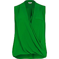 Green wrap front sleeveless blouse