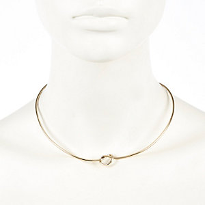 Gold tone skinny knot torque necklace