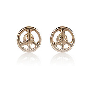 Gold tone tiny peace stud earrings