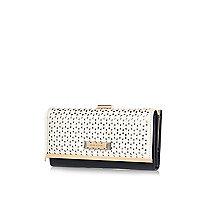 White laser cut clip top purse