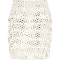 Cream punched leather-look mini skirt