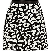 Black animal print mini skirt