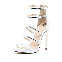 White silver strappy barely there sandals