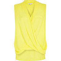 Yellow wrap front sleeveless blouse