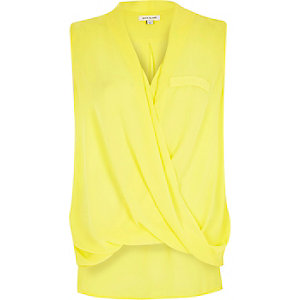 Yellow wrap front sleeveless blouse