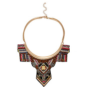 Gold tone beaded tribal torque necklace