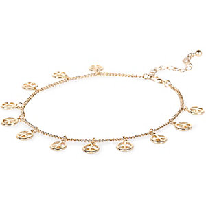 Gold tone repeat peace symbol anklet