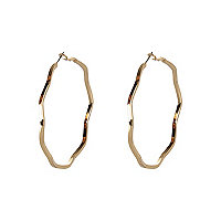 Gold tone wavy hoop earrings.