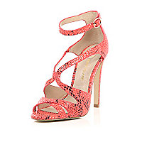 Orange snake print caged heeled sandals