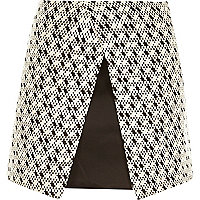 Black geometric print wrap front mini skirt