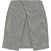 Black print wrap front mini skirt