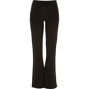 Black fitted ponte 70s flared leggings
