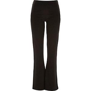 Black fitted ponte 70s flared leggings