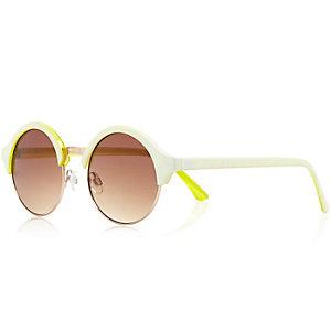 White yellow background round sunglasses
