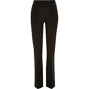 Black 70s flare trousers
