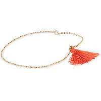 Gold tone coral tassel torque necklace