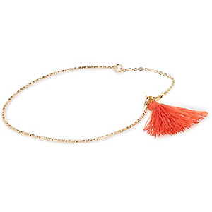 Gold tone coral tassel torque necklace