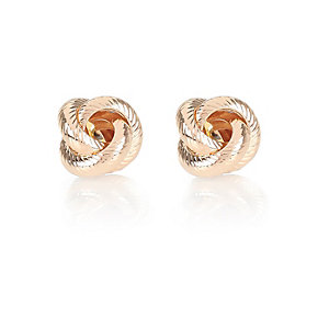 Gold tone knotted stud earrings