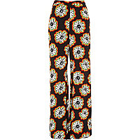 Red flower print palazzo trousers