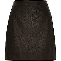 Black textured A-line mini skirt