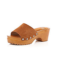 Light brown clogs