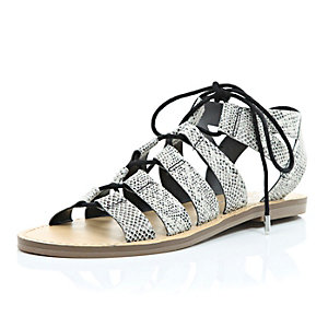Black snake print gladiator sandals