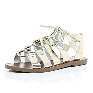 Metallic gold gladiator sandals