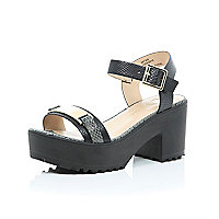 Black chunky cleated sole snake print sandals