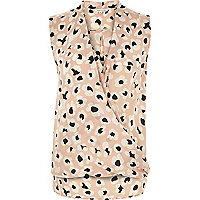 Pink animal print sleeveless wrap blouse