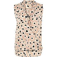 Pink animal print sleeveless wrap blouse