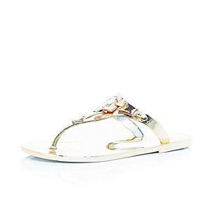 Gold embellished jelly flip flops