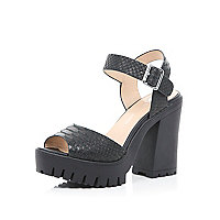 Black snake print chunky cleated sole heels