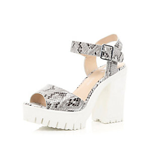White leather snake chunky cleated sole heels