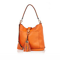 Orange tassel front slouchy handbag