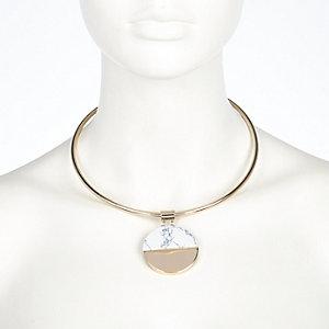 Gold tone precious stone torque necklace