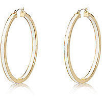 Gold tone white snake print hoop earrings