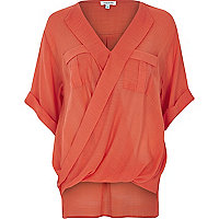 Red wrap front pocket blouse