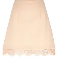 Light pink woven lace hem mini skirt