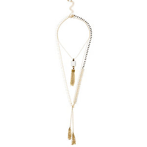 Gold tone tassel layer necklace