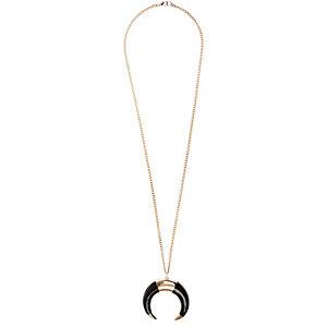 Gold tone tusk pendant necklace