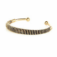 Gold tone woven cuff bracelet