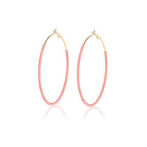Pink woven hoop earrings