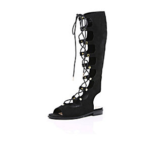 Black faux suede high leg gladiator sandals