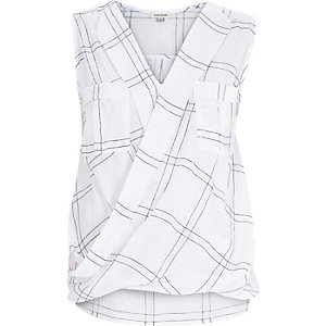 White check sleeveless wrap front blouse