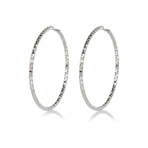 Silver tone oversized faceted hoop earrings