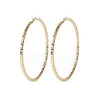 Gold tone oversized faceted hoop earrings